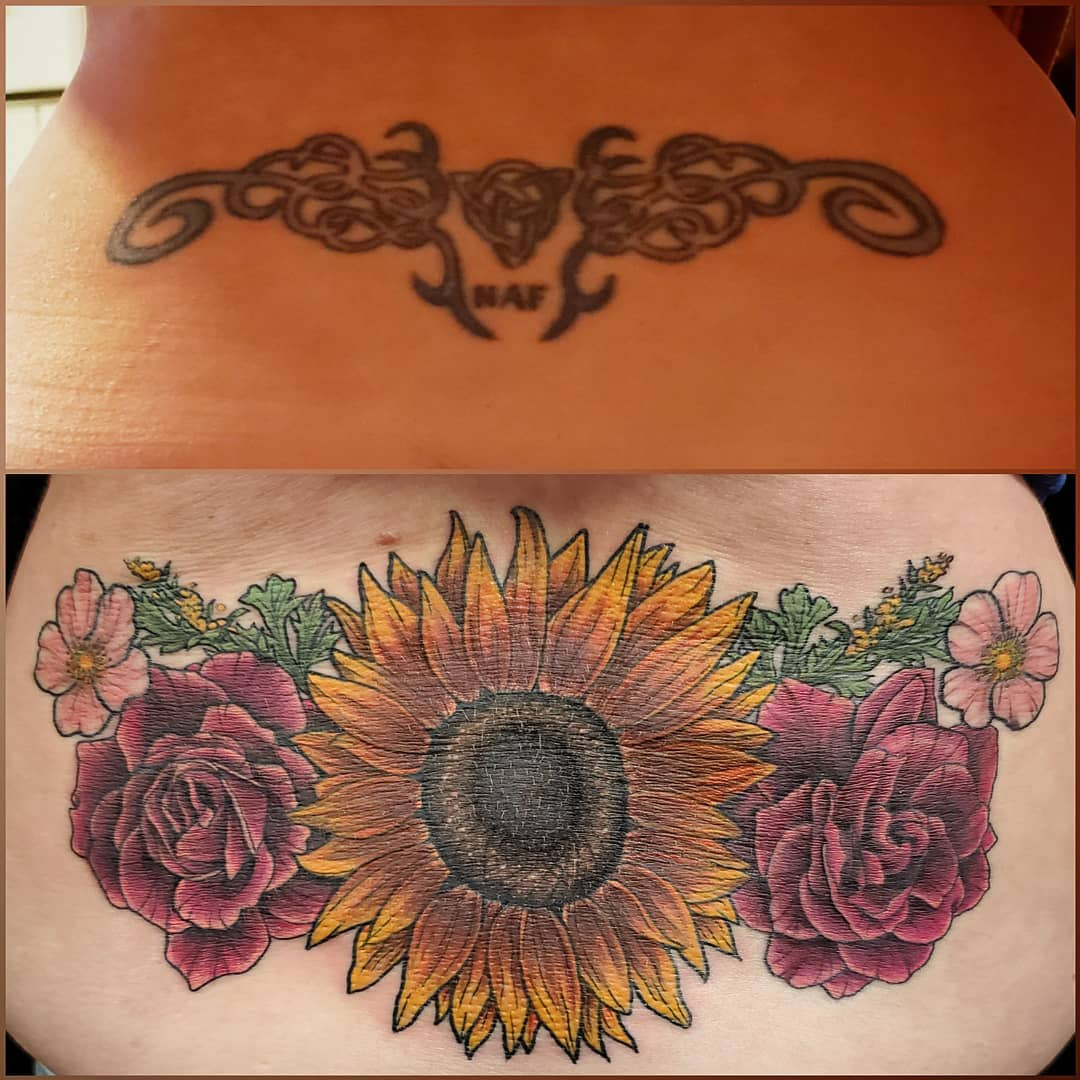 sunflower lower back tattoo