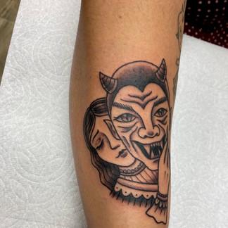 Devil face tattoo