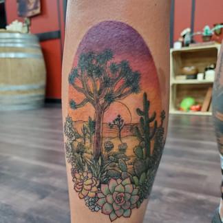 Desert scene tattoo