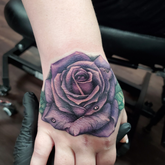 Rose hand tattoo