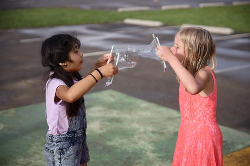 FernLeaf Community Charter School Children blowing bubbles