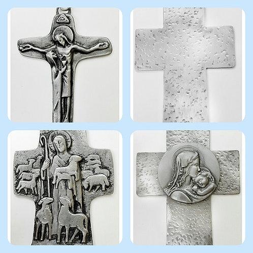 Cruces de peltre