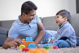 mexican-father-son-playing-carpet-home.j