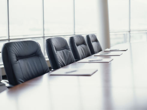 Canva - conference table with chairs.jpg
