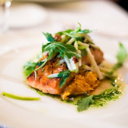 Cider Glazed Bay of Fundy Salmon with an apple arugula salad atop sweet potato mash with toasted pec