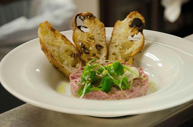 Steak Tartar with a caper white anchovy vinaigrette & a #local Schoonmaker farm quail egg