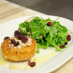 Warm chèvre salad with toasted hazelnuts, dried cranberries & arugula