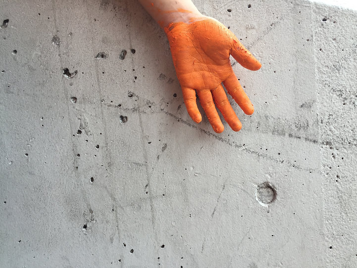Concrete wall with hand painted orange