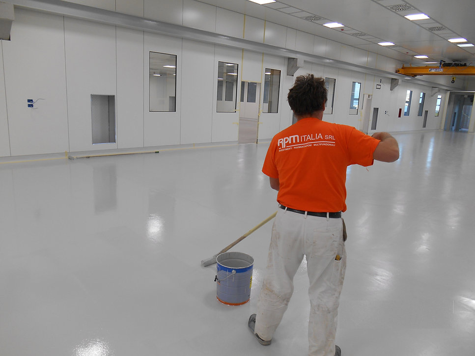 An RPM Italia installer is completing a resin flooring
