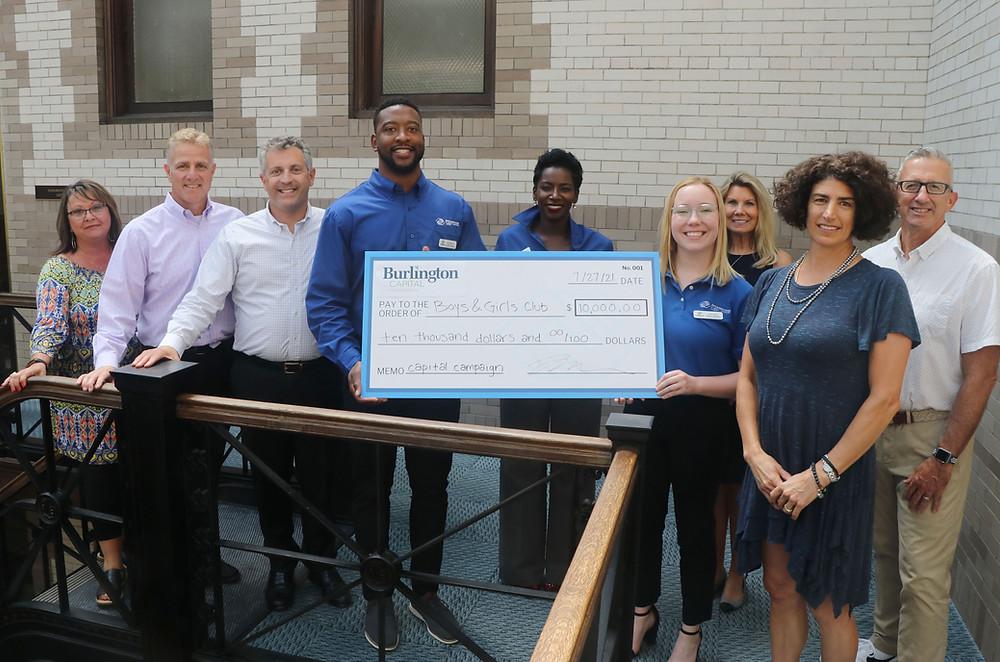 Burlington Capital staff present a check for $10,000 to the Boys & Girls Club team.