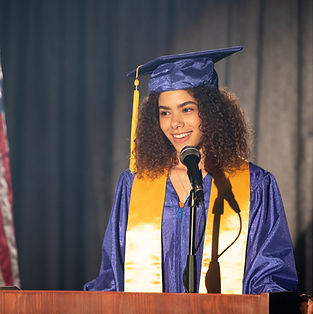 Graduating girl stands at podium