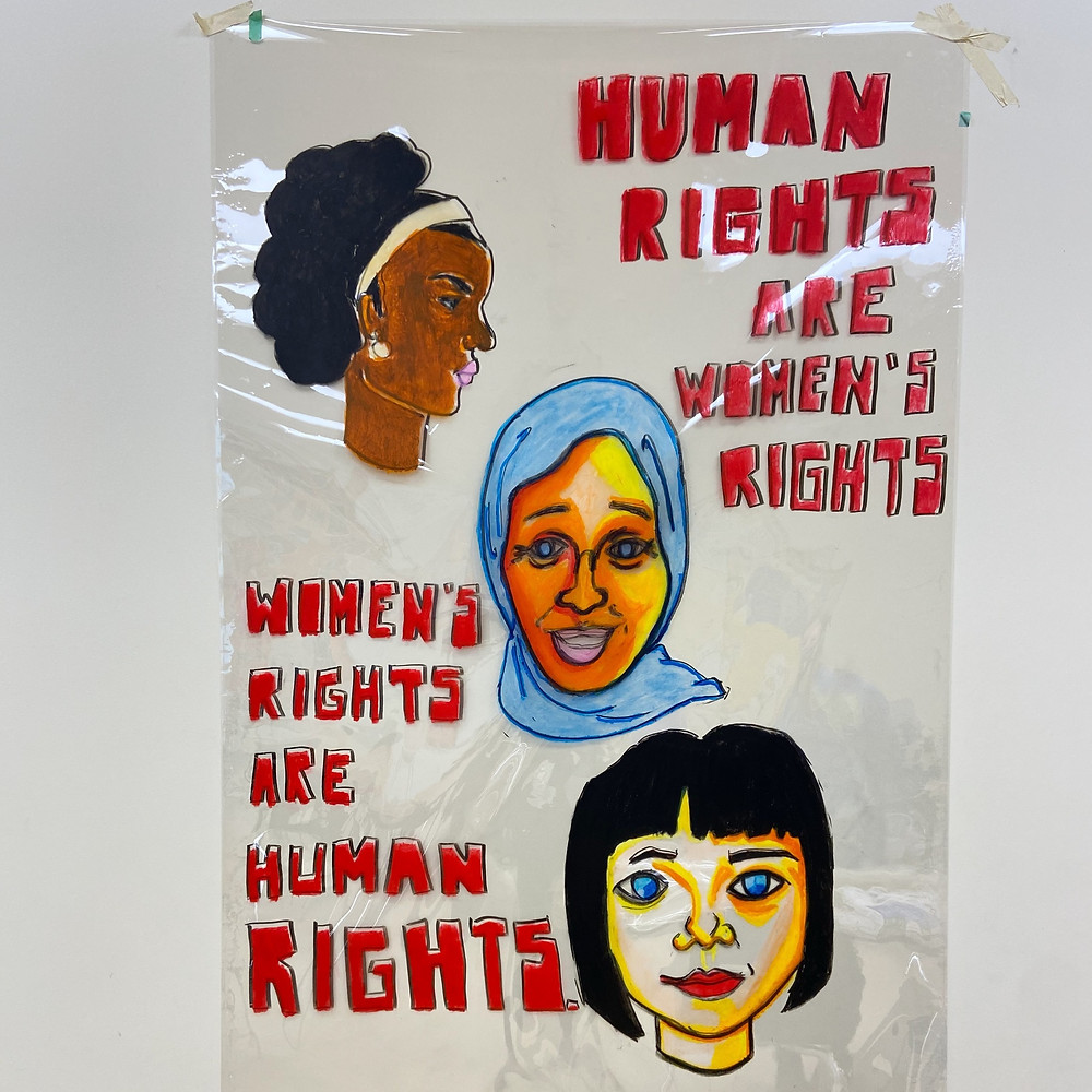 """Women's History Month poster that says, """"Human rights are women's rights. Women's rights are human rights."""""""