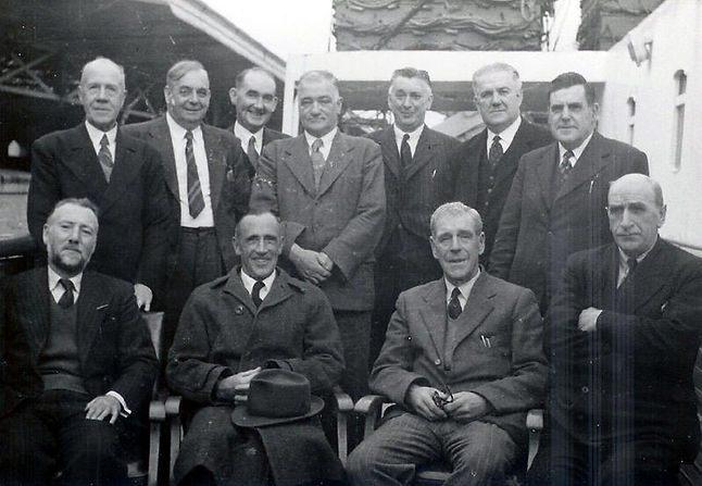 On one of the early mailboats, back row; Capt Richard Woodall, Capt Borthwick, Capt Horspool, Capt N Lloyd Williams, Capt Robert Sherwood, Holyhead's Station Master and Capt Dick Thomas. In front are (L) Capt Aderne, Capt Manning, Jack Gibson Supt Eng & Ca