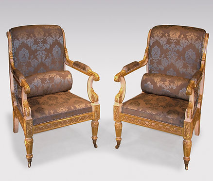 Important Pair of Regency period white painted and carved giltwood Armchairs