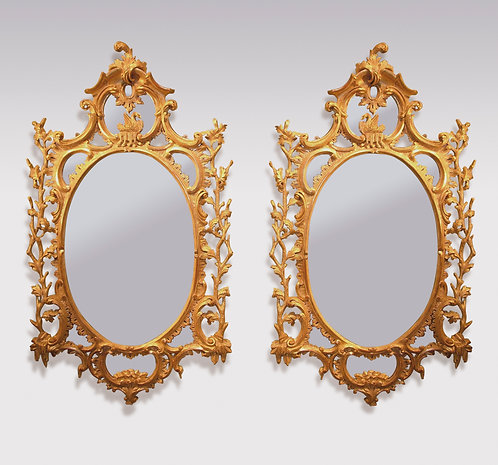 Important Pair of Mid-18th Century Oval Giltwood Mirrors