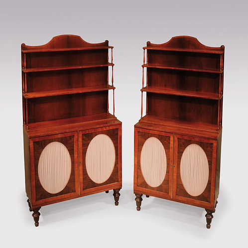 Pair Regency rosewood and satinwood banded cabinets with oval panelled doors