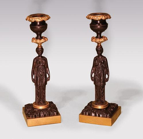 A Pair of 19th Century Regency period bronze & ormolu Lady Candlesticks