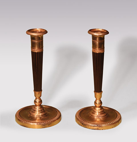 A pair of early 19th Century bronze and ormolu Candlesticks