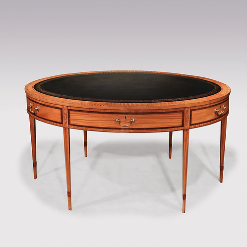 A Fine Mid 19th Century Satinwood Oval Writing Table SOLD