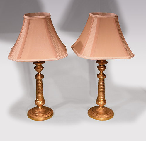A pair of 19th century ormolu candlestick lamps