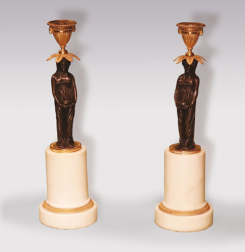 19th Century bronze and ormolu Candlesticks, raised on Vestal Virgin stems. SOLD