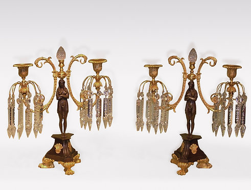 A Pair of early 19th Century bronze and ormolu 2-light Lustre Candlesticks.