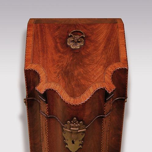 A George III period figured mahogany serpentine Cutlery Box
