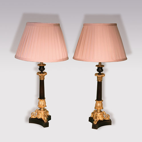 A pair of mid 19th century bronze and ormolu Candlestick Lamps