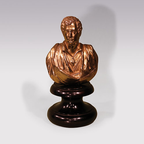 A gilt brass bust of Lord Byron
