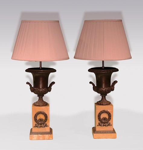 Pair of bronze campana-shaped Urns