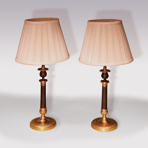 A pair of early 19th Century bronze and ormolu Candlestick Lamps