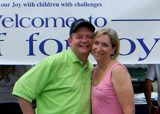Annette and Jim at the start of Golf for Joy 2013