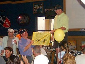 Jim Brochowski accepts celebratory flag at Golf for Joy 2004