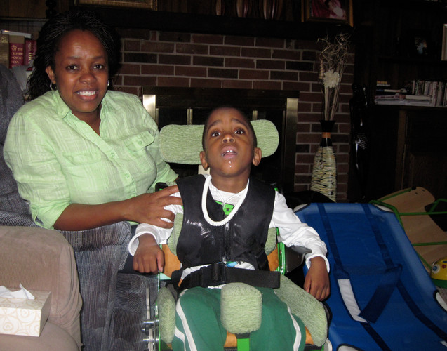 In April of 2010 we gave Santagie a bath seat and in June of 2010 we gave him a tilt and reclining chair.