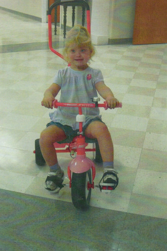 In June of 2010 we gave Emily foot holders to help her ride her bike.