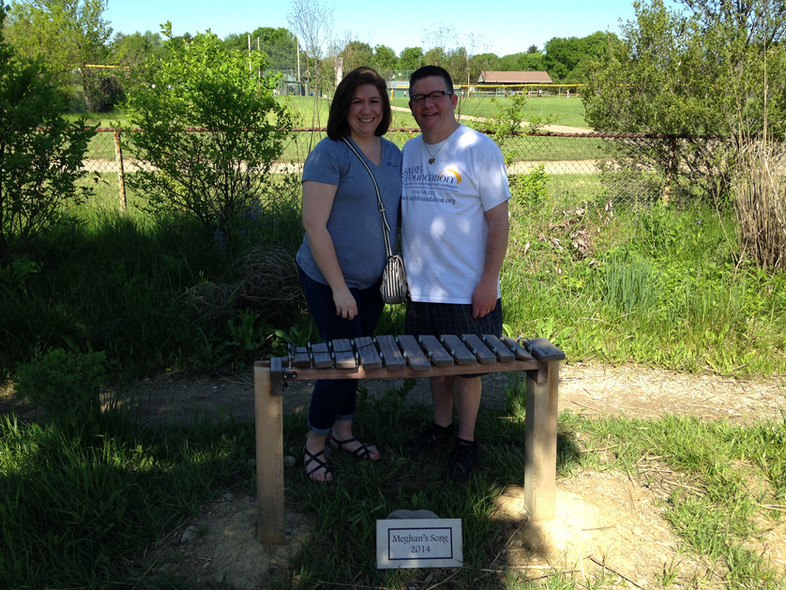 Kailey and Jim Brochowski with 'Meghan's Song' xylophone.