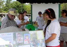 2013 Rick & Volunteers at Check-In.JPG