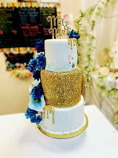 Gold dripping and gold sequence , flowers provided by the bride