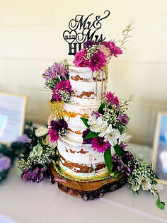fresh flowers compliment this naked cake
