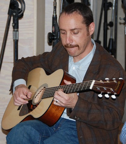 06-Greg Reish Intently Picking at Studio B