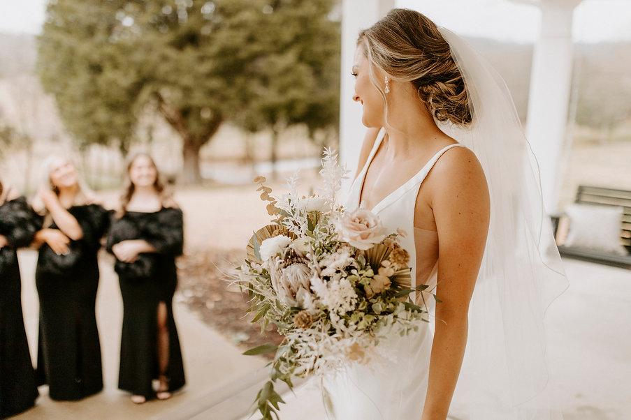 beautiful bride with bridesmaid