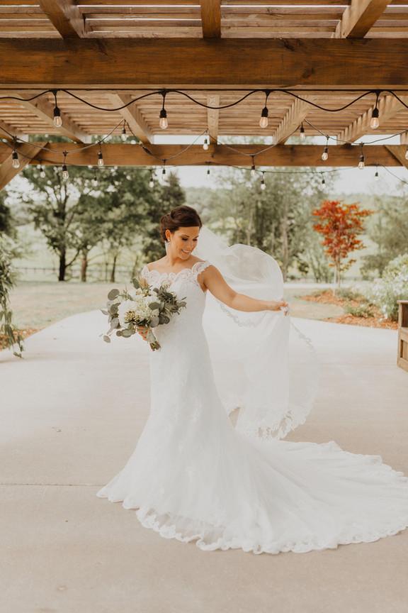 Bride under the Bethany Cottage Pergola