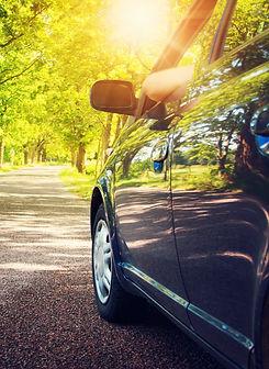 Car on asphalt road in summer_edited.jpg
