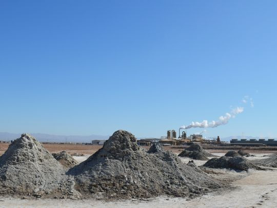 EnergySource's Featherstone geothermal plant by the Salton Sea belches steam on April 29, 2016, with mud pots in the foreground. (Photo: Robert Hopwood/The Desert Sun)