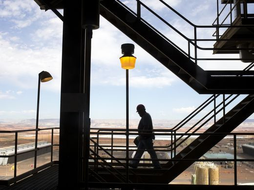 Alex Tsinnjinnie of the operations department walks on the 200-foot level Aug. 16, 2016, at Navajo Generating Station near Page.