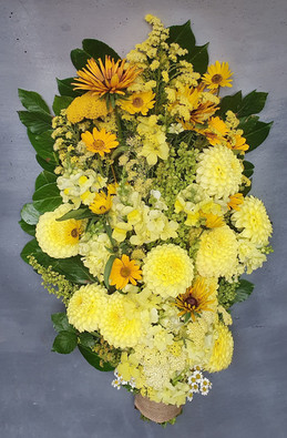 funeral-flowers-yellow-black-shed