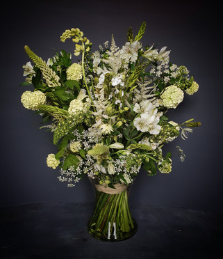 green-white-arrangement-black-shed-flowe