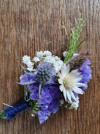 black-shed-buttonhole-blue