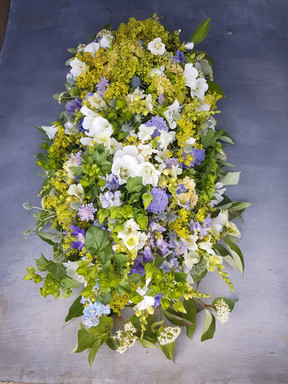fresh-green-funeral-flowers-black-shed