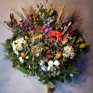 colourful-funeral-flowers-black-shed